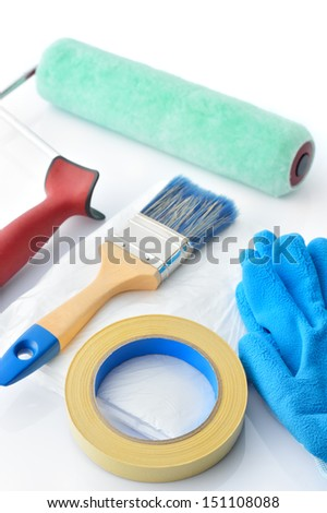 Painting tools on white background. Masking tape, brush, drop cloth, paint roller and gloves on white background.