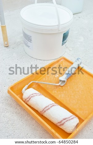 painting tools with bucket on grid - stock photo