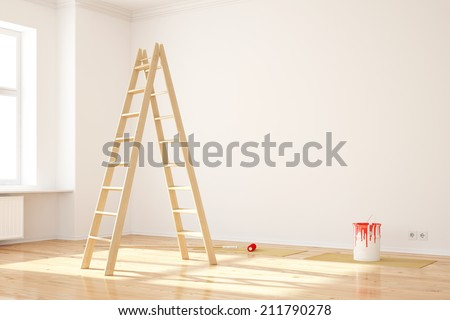 Painting walls in room with ladder during renovation - stock photo