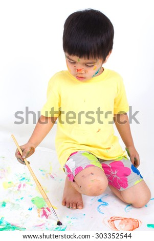 painting watercolor on white paper by little boy - stock photo