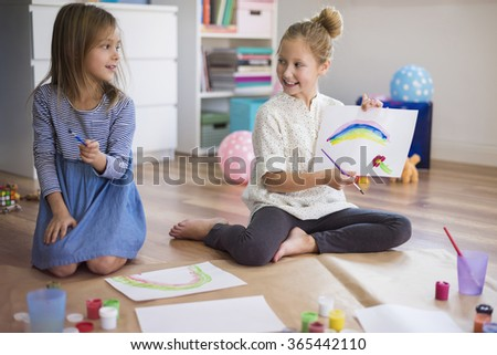 Painting with sister is always great fun - stock photo