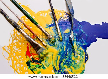 Paints and brushes on a white background - stock photo