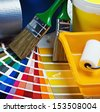 paints and paint repair on the architectural plan. focus on drawing brush - stock photo