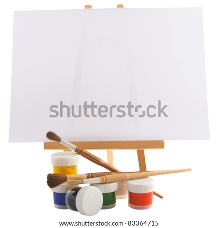 paints, brushes and easel isolated on white - stock photo