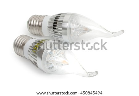 Pair energy saving LED light-emitting diode candle bulbs with socket type E27 isolated on a white background, close up. - stock photo