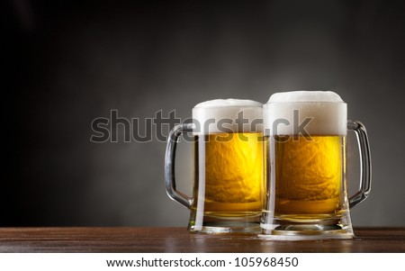 pair glasses of beer - stock photo