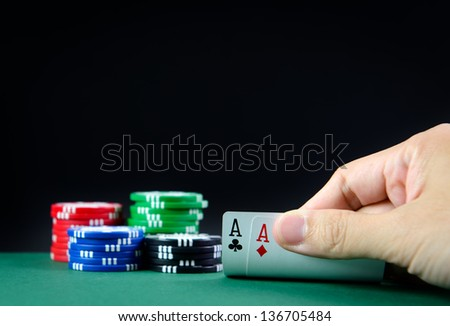 Pair of aces and casino poker chips - stock photo