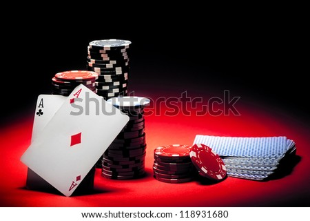 Pair of aces and poker chips - stock photo