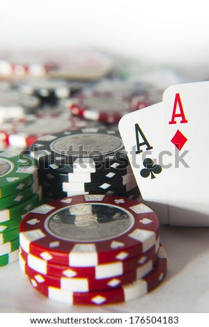 Pair of aces poker hand in front of poker chips stack