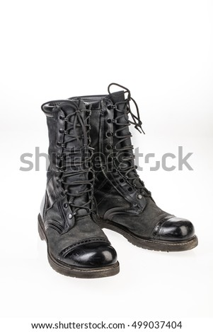 Pair of army boots on an isolated studio background