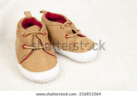 pair of baby shoes on fur - stock photo