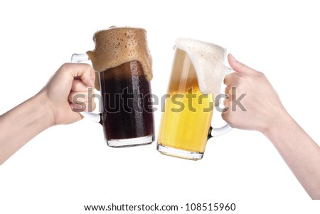 Pair of beer glasses with hand making a toast isolated on a white background - stock photo