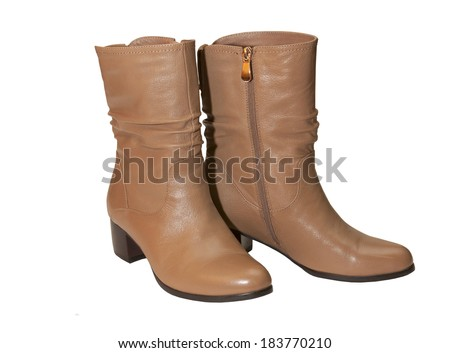Pair of beige female boots over white background - stock photo