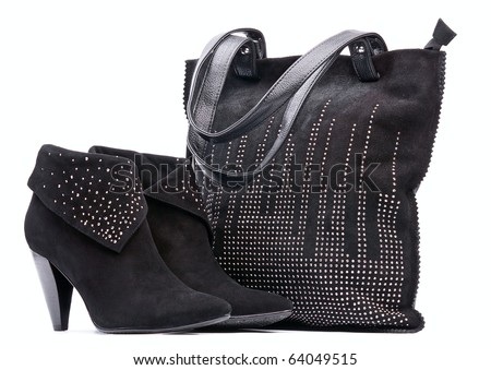 Pair of black female suede boots and suede bag on the white background - stock photo