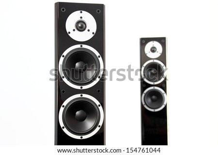 Pair of black glossy audio speakers isolated on white background