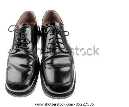 Pair of black shoes on plain background