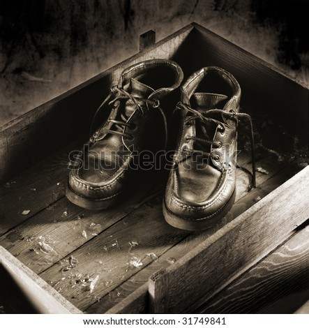 Pair of boots in a wood box