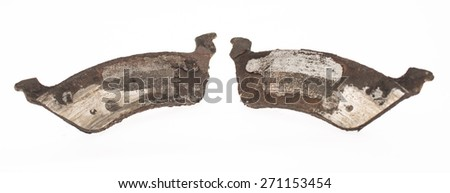 Pair of brake pads worn down all the way to the metal. - stock photo