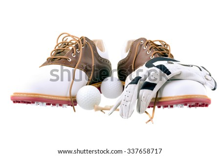 Pair of brand new golf shoes with ball glove and tees isolated on white