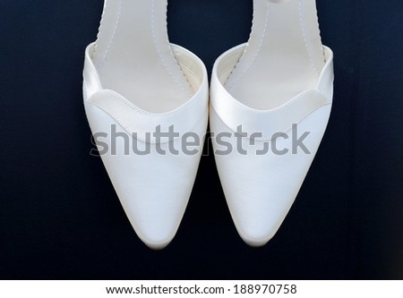 Pair of brides white shoes closeup  - stock photo