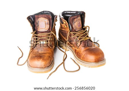 Pair of brown boots on white background - stock photo