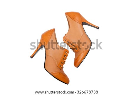 Pair of brown female boots over white background - stock photo