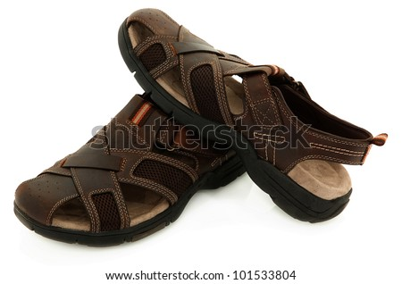 Pair Of Brown Leather Sandals Over White Background - stock photo