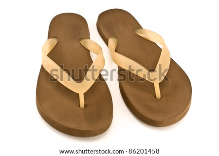 Pair of brown rubber flip flop sandals isolated on white - stock photo