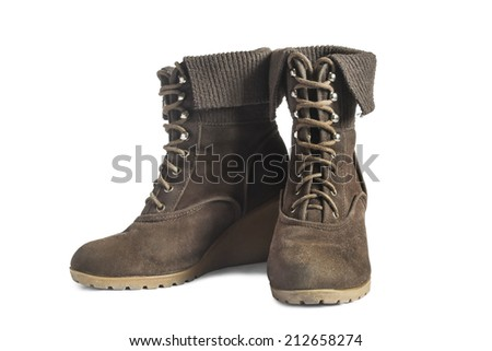 Pair of brown suede wedge boots with lacing isolated over white
