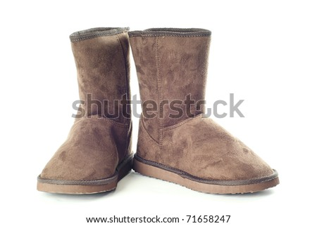 Pair of brown winter boots over pure white background