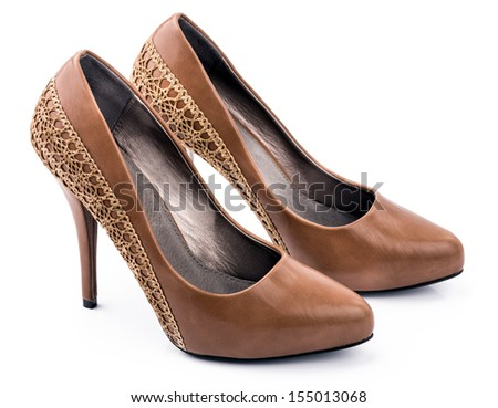 Pair of Brown woman shoes An elegant pair of woman's brown shoes on a white background. - stock photo