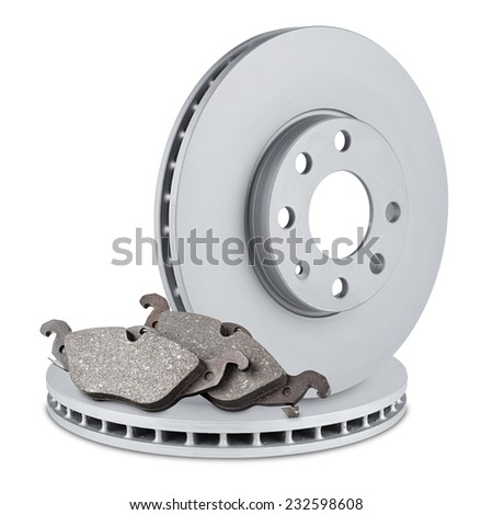 pair of car brake discs and pads on white background - stock photo