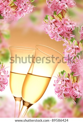 Pair of champagne flutes on a pink hyacinth background - stock photo