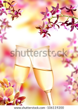 Pair of champagne flutes on orchid background - stock photo