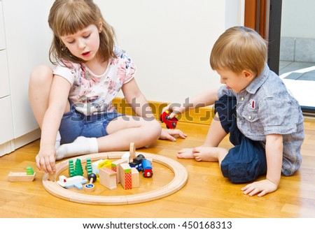 pair of children playing in the room