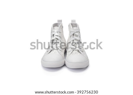 Pair of childs white sequined ankle boot shot at a 3/4 angle on a white background