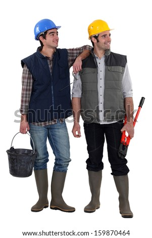 Pair of construction workers - stock photo