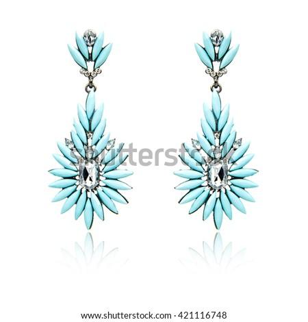 Pair of diamond earrings isolated on white - stock photo