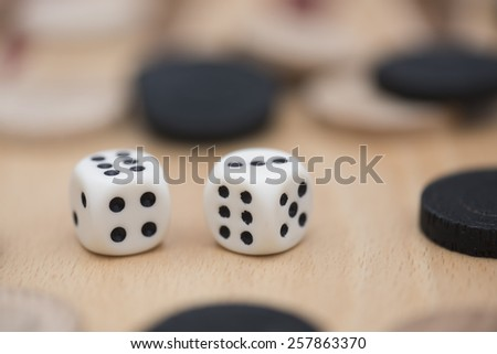 Pair of dice among other pieces - stock photo