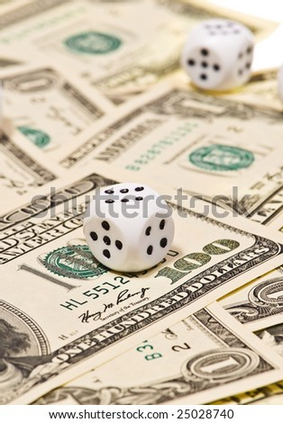 Pair of dice on money