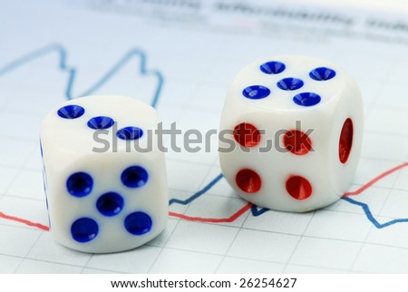 pair of dices  on financial chart - stock photo