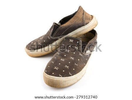 Pair of Dirty Worn Shoes One Another on White Background. - stock photo