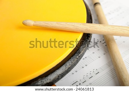 Pair of drumsticks, training pad and note paper