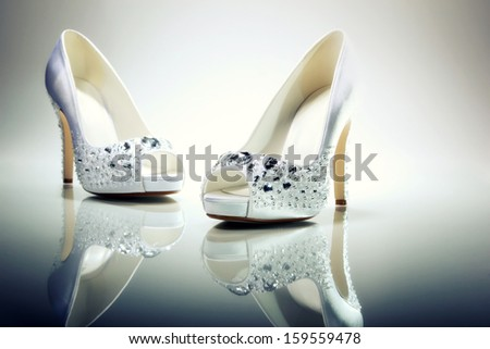 Pair of Elegant Brides white shoes  - stock photo