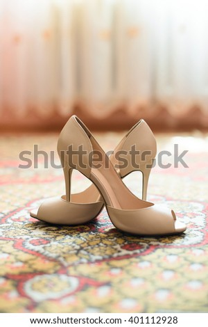 pair of elegant shoes on carpet - stock photo