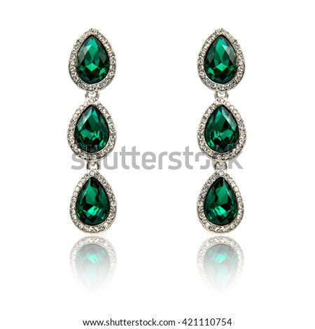 Pair of emerald earrings isolated on white - stock photo