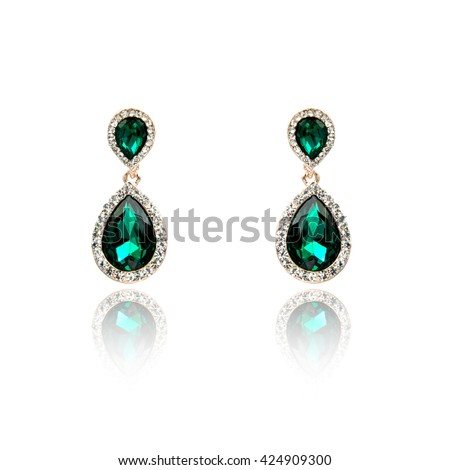 Pair of emerald earrings isolated on white