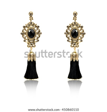 Pair of fashion earrings isolated on white