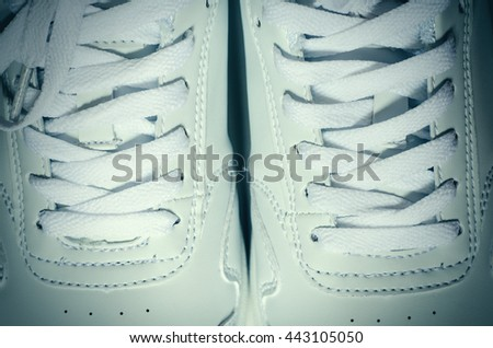 pair of fashionable sneakers top view - stock photo