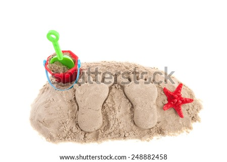 Pair of feet in the sand at the beach isolated over white background - stock photo